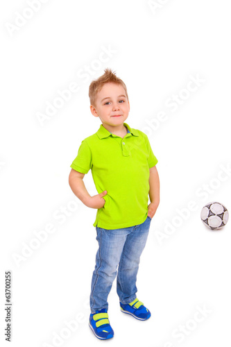 Smiling little boy with a soccer ball