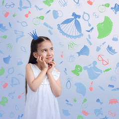 Girl kid on background of texture of girl's things