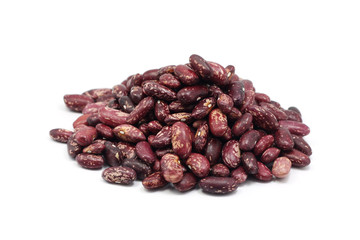 a handful of seeds of red beans on white background