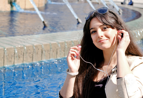 young girl listening  music with earphones