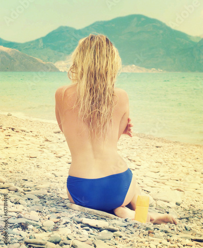 girl sunbathes on a beach