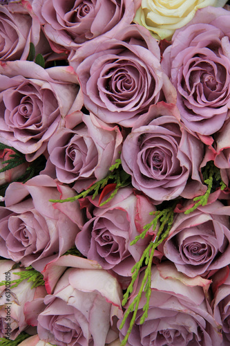 Purple roses in a wedding arrangement