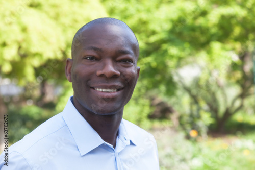 Laughing african man in a park