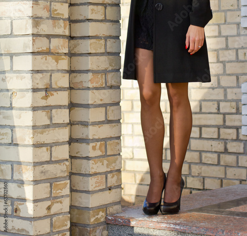 Girl standing on parapet with white columns