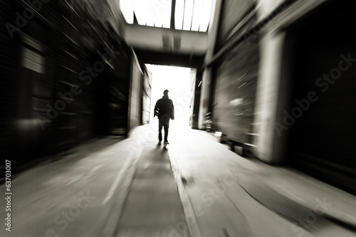 people through doorway at a factory building,motion blur