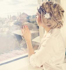 beatiful girl looking through window