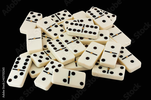 many white dominoes isolated on a black background