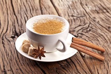 Cup of cappuccino decorated with spices.