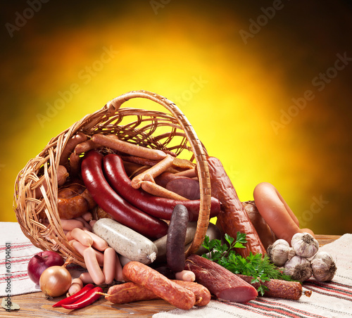 Variety of sausage products in the basket.