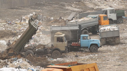 Garbage machines unload garbage on a municipal dump in Ukraine