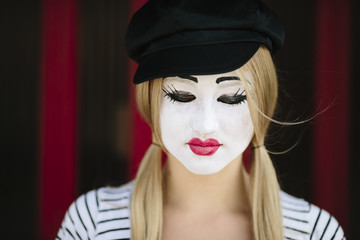 sad mime with black hat