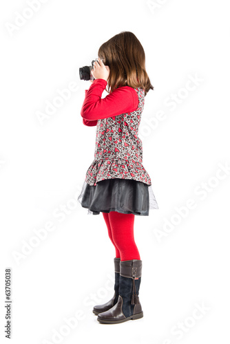 Girl taking a picture over white background