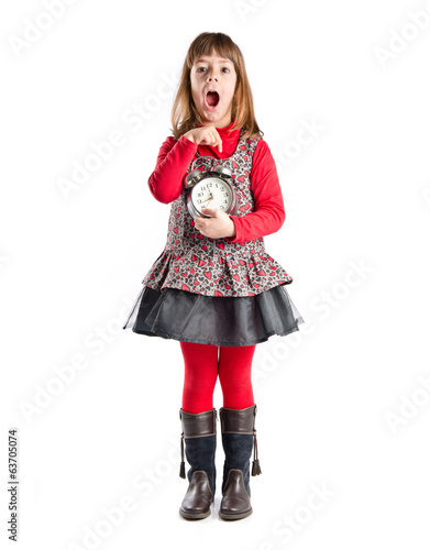 Young Girl holding an antique clock over white background