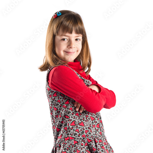 Girl with hers arms crossed over white background