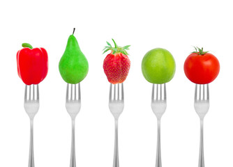 Dietary concept, vegetables and fruit on a fork
