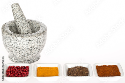 Stone mortar with pestle and spices
