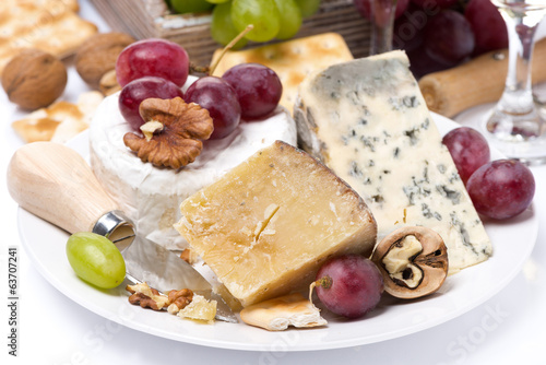 assortment of cheeses, grapes and crackers, close-up