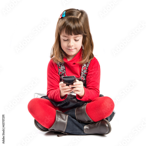 Young girl sending a message with her mobile
