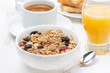 muesli, coffee and orange juice for breakfast