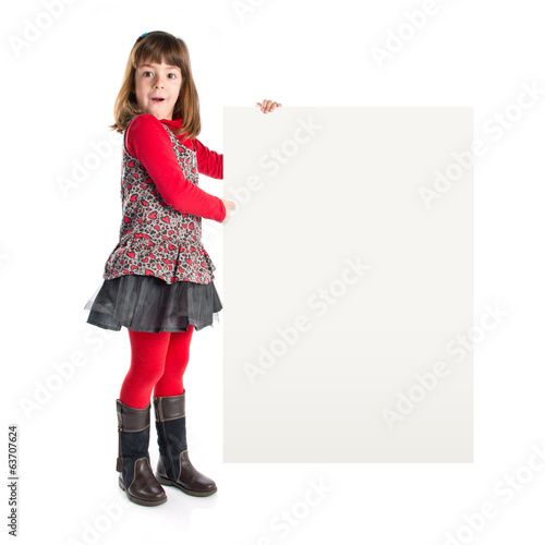 Young girl holding placard