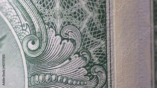 One dollar bills, close up, rotate. Macro.