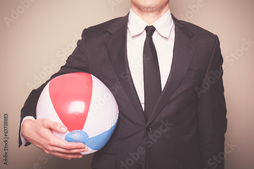 Businessman with beach ball