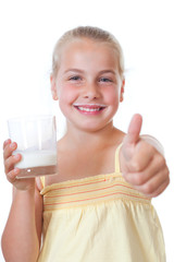 girl with a glass of milk and thumb up