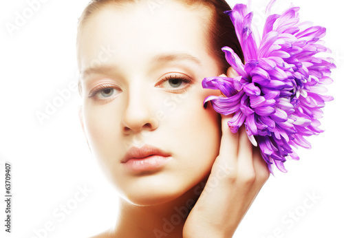 woman portrait with chrysanthemum. Spa treatment.