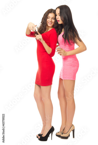 Two young girls with mobile phones