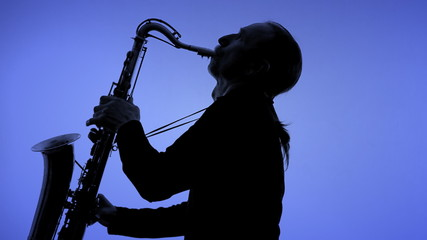 Man playing sax in silhouette
