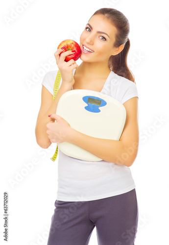 Young healthy girl with scales and apple
