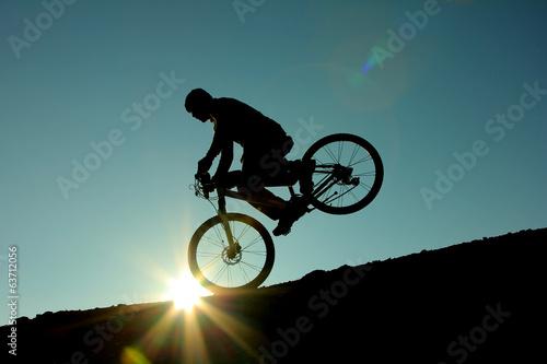 Fotobehang Wielersport bisiklet şov gündoğumunda