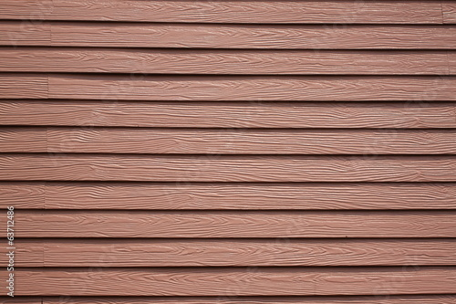 walls of the house are made of oak wood color.