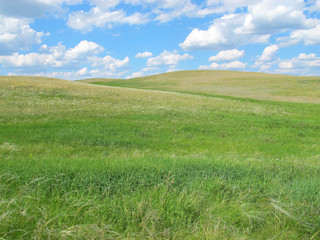 Steppe hills against a blue sky