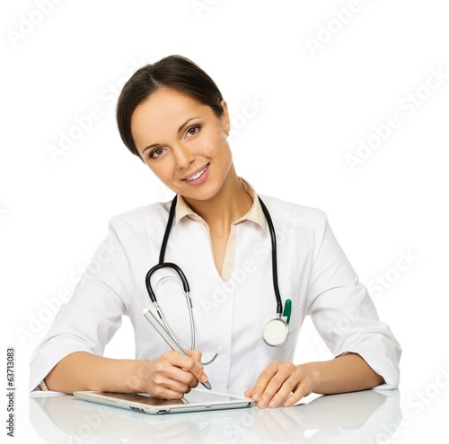 Young positive brunette doctor woman taking notes on tablet pc