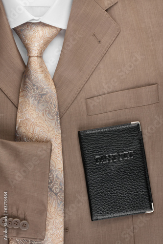 Passport lying on the jacket, tie and shirt