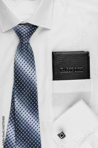 Passport lying on the shirt  and tie