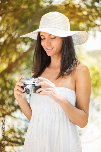 Woman with retro photo camera