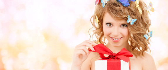 teenager with butterflies in hair opening present