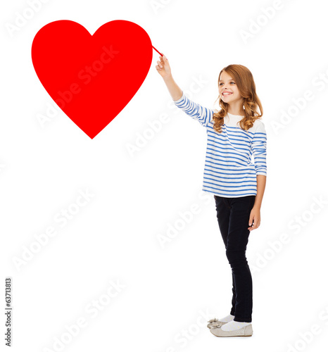 girl drawing big red heart in the air