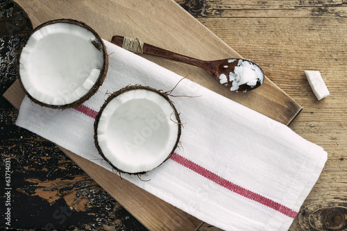 Coconut and coco oil on wooden background