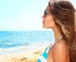 Beauty Girl Wearing Sunglasses over Ocean.  Vacation Concept