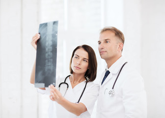 two doctors looking at x-ray