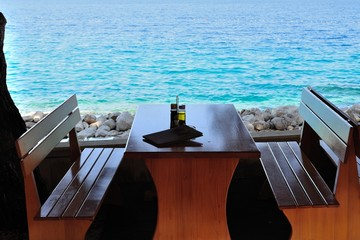 Table with bottles in restaurant on the beach