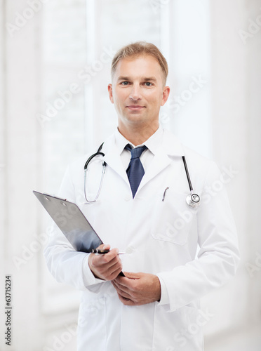 male doctor with stethoscope and clipboard