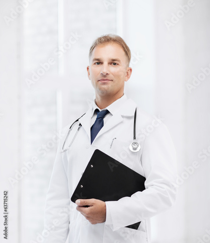 male doctor with stethoscope and notes