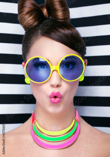 Attractive surprised young woman wearing sunglasse