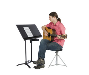 Musician looking at music notation and playing
