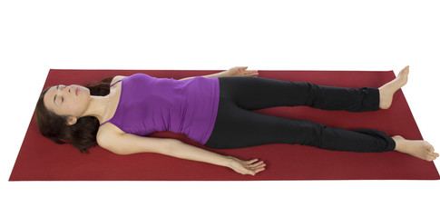 Woman resting in Shavasana