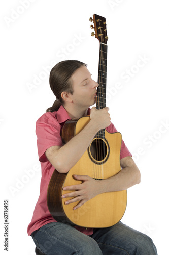 Male guitarist holding his guitar